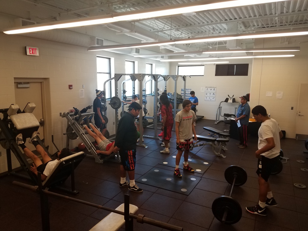 Football team training in weightroom