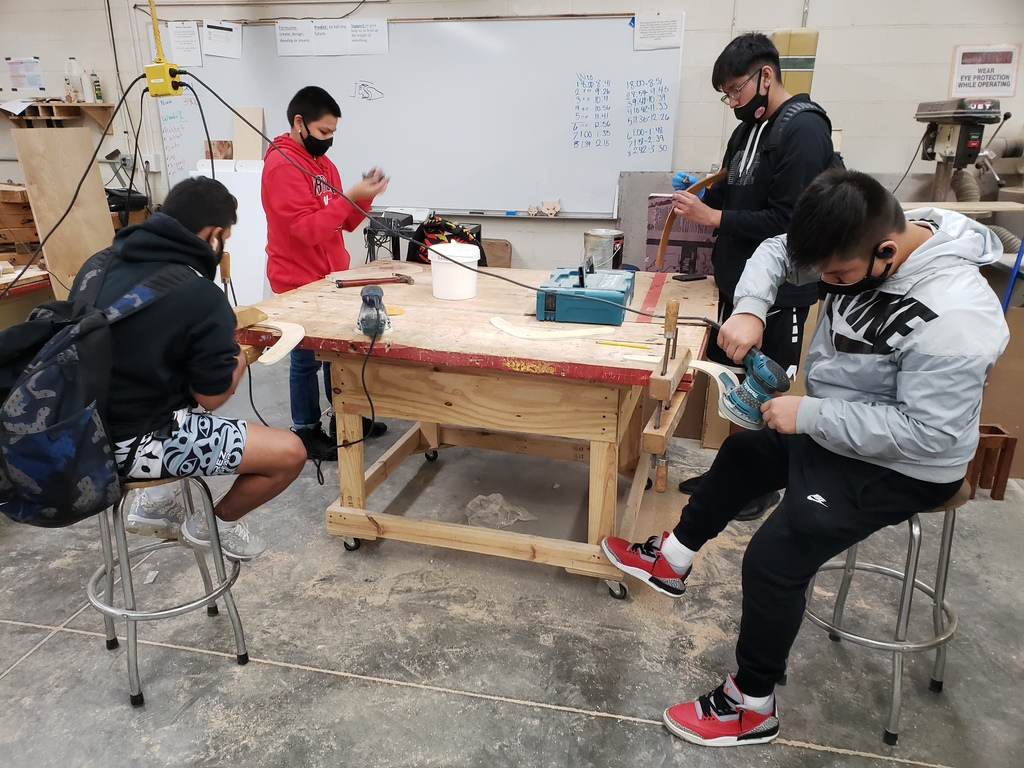 Students hard at work in woods class.